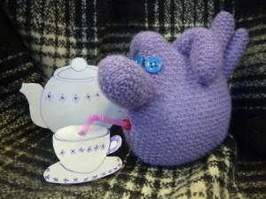 upcycled wool glove creature drinking tea